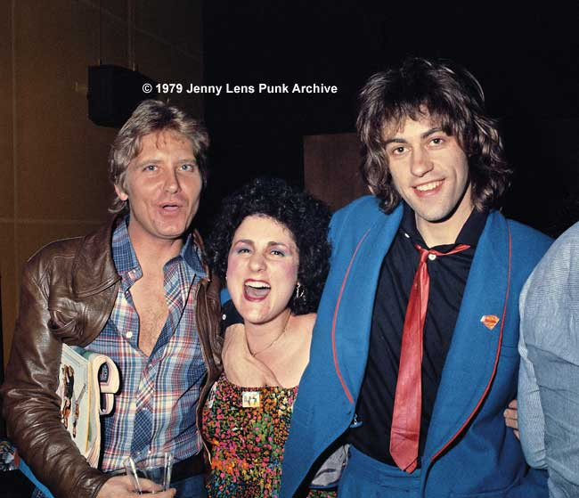 February 26, 1979, Jan Golab, writer for Oui Magazine, Jenny Lens and Sir Bob Geldof, during Boomtown Rats' first LA press conference. I don't wear a bra and Bob just copped a feel. Hence my expression. Look how innocent he looks! Ha, the Rats were GREAT fun on and off stage!